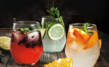 Glasses of gin with fruit and various garnish